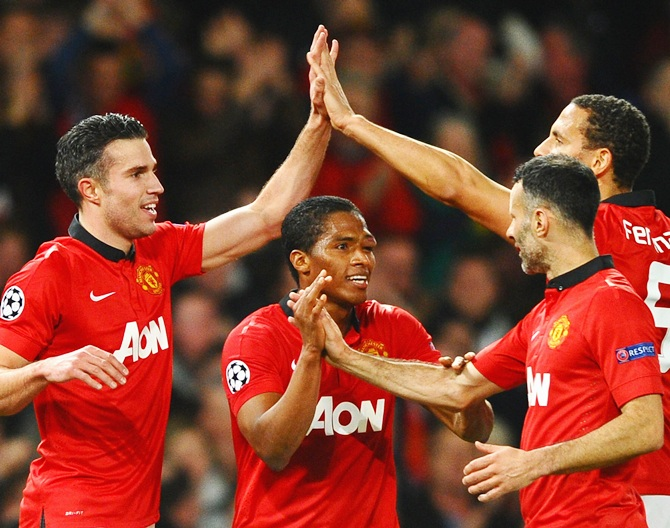 Robin van Persie of Manchester United celebrates scoring the goal with his team-mates