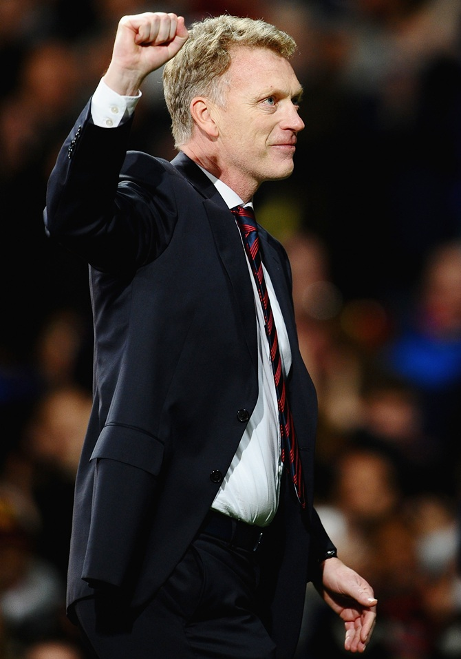 Manchester United Manager David Moyes celebrates at the end   of the UEFA Champ