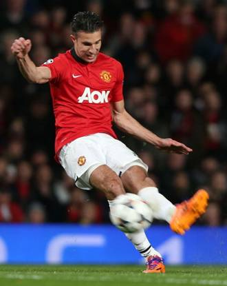 Robin van Persie scores their third goal during the UEFA Champions League Round of 16 second leg match between Manchester United and Olympiacos FC at Old Trafford