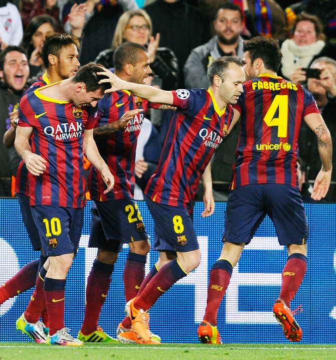 From left, Lionel Messi of Barcelona celebrates with teammates Neymar, Daniel Alves, Andres Iniesta and Cesc Fabregas