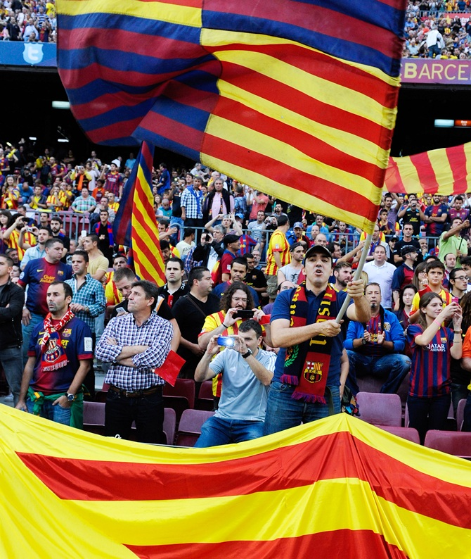 FC Barcelona supporters cheer their team during a La Liga match