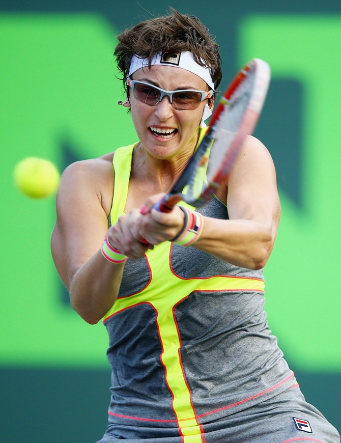 Yaroslava Shvedova of Kazakhstan returns the ball against Serena Williams