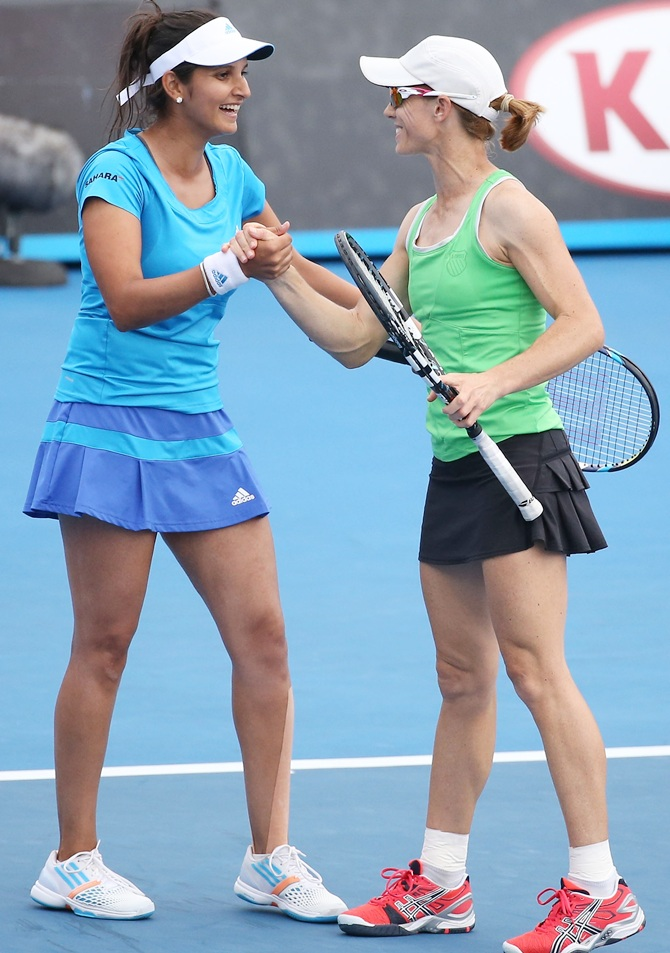 Sania Mirza of India and Cara Black of Zimbabwe celebrate