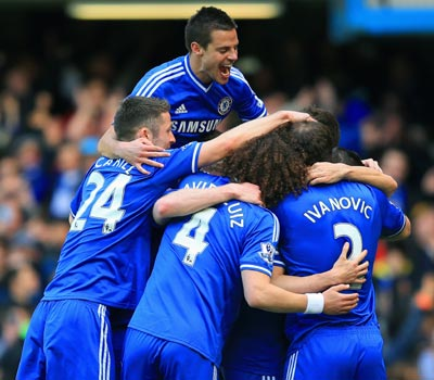 Chelsea hit Arsenal for six, Liverpool and City win big