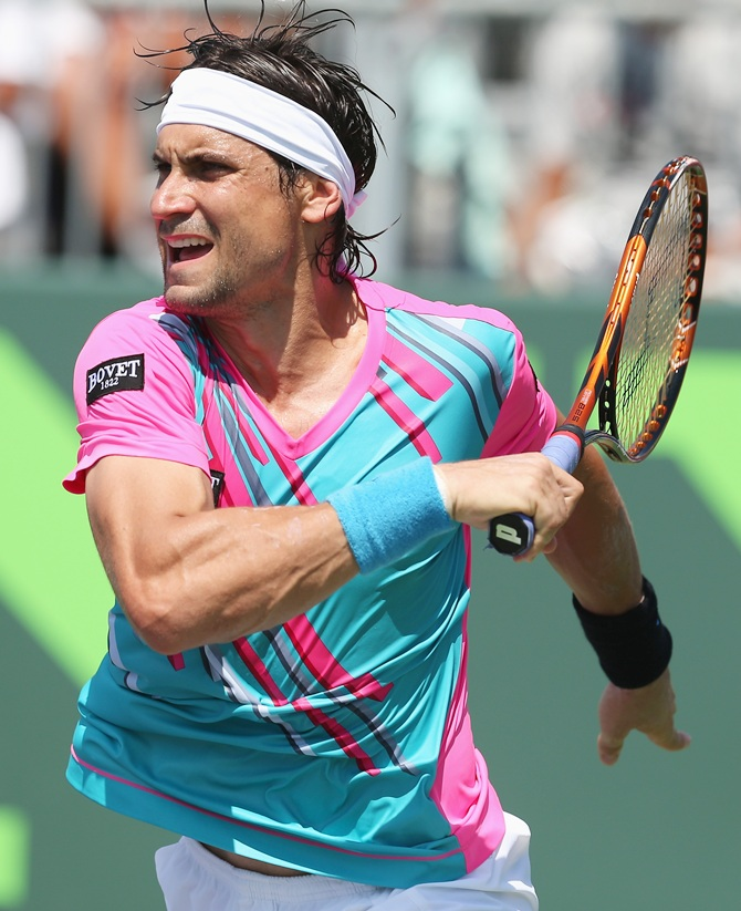 David Ferrer of Spain in action against Teymuraz Gabashvili of Russia