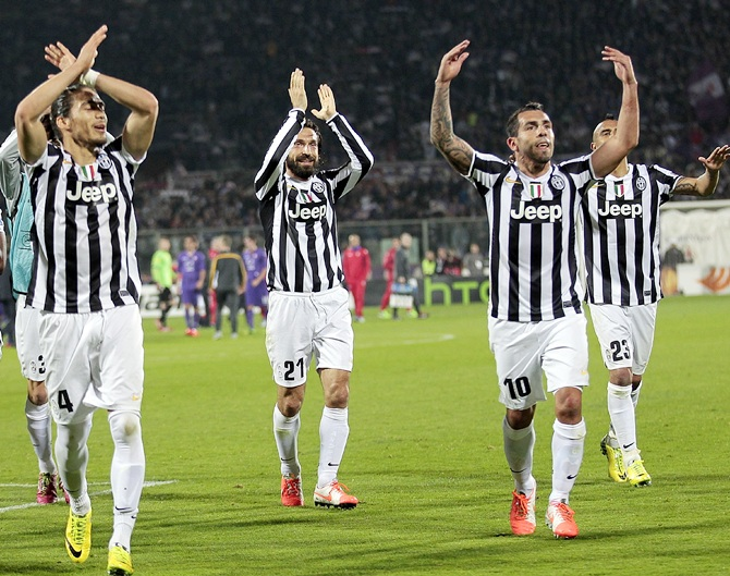 Juventus players celebrate after Carlos Tevez (right) scored against Catania