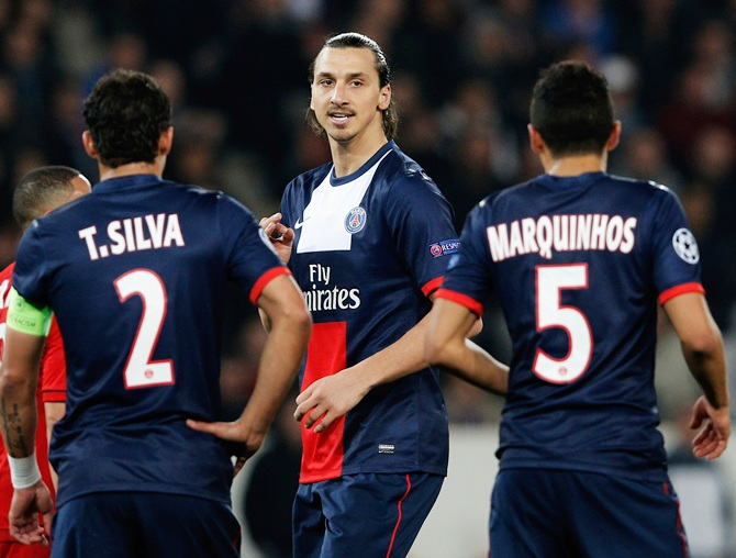 Zlatan Ibrahimovic,centre, of PSG speaks to teammates Thiago Silva and Marquinhos