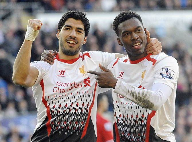 Liverpool's Daniel Sturridge (right) celebrates with Luis Suarez after scoring against Cardiff City on Saturday