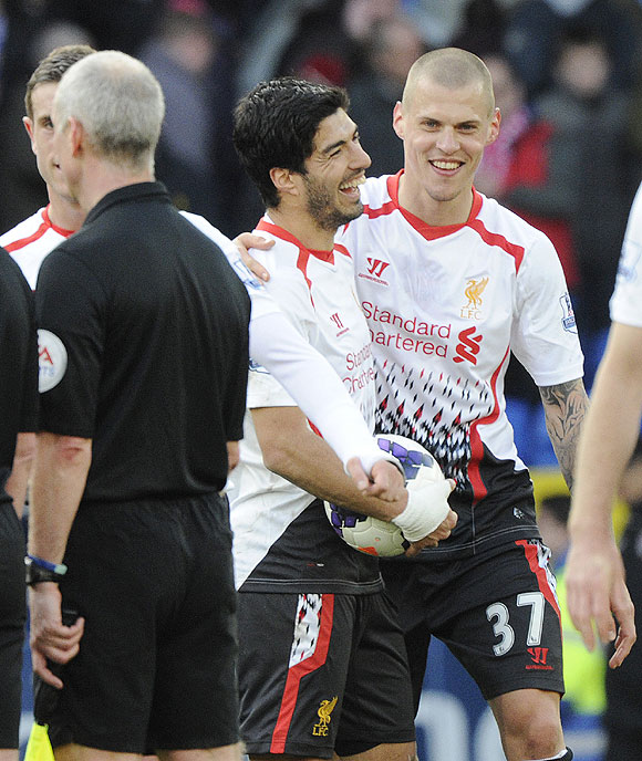 Liverpool's Luis Suarez (left)celebrates with Martin Skrtel