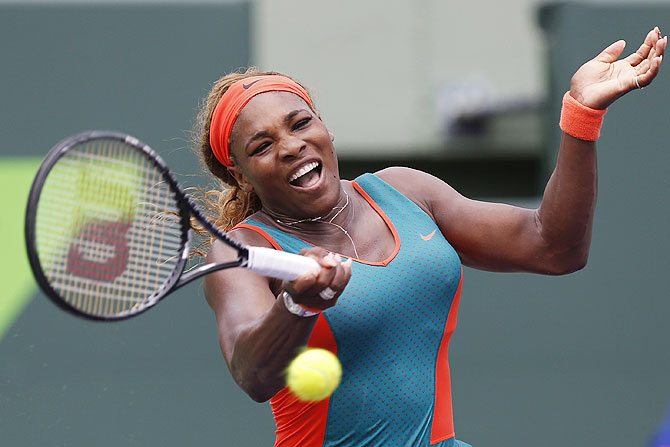Serena Williams hits a forehand against Caroline Garcia