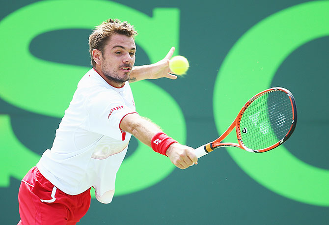 Stanislas Wawrinka of Switzerland returns a shot to Daniel Gimeno Traver of Spain on Saturday