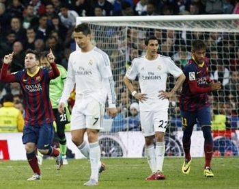 Barcelona's Lionel Messi (left) and Neymar (right) celebrate a goal as  Real Madrid's Cristiano Ronaldo (second left) and Angel Di Maria (second right) walk back during La Liga's second ''Clasico'' match of the season at Santiago Bernabeu stadium in Madrid.