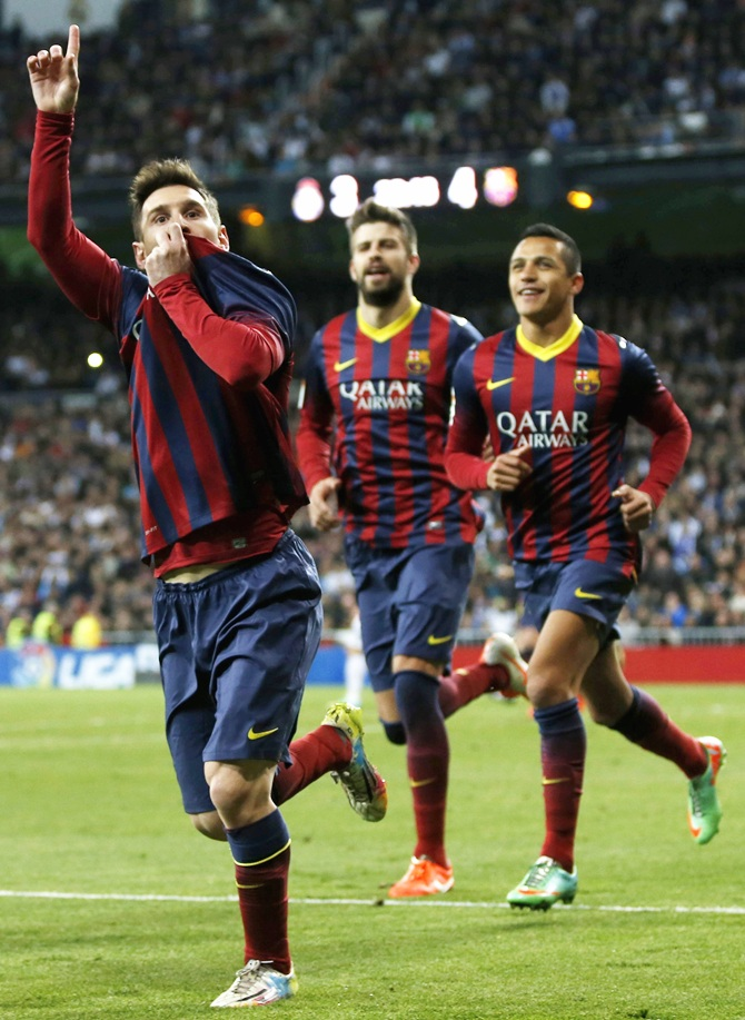 From left, Barcelona's Lionel Messi, Gerard Pique and Alexis Sanchez celebrate