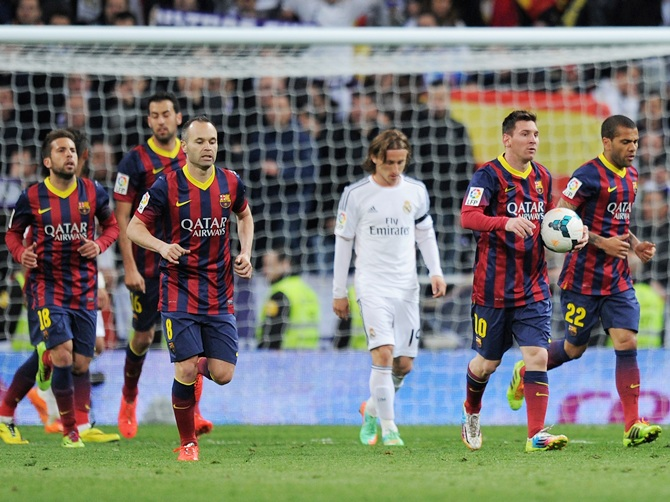 Lionel Messi of Barcelona runs the ball back to the centre spot after his first goal