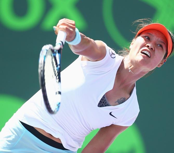 Li Na of China serves the ball