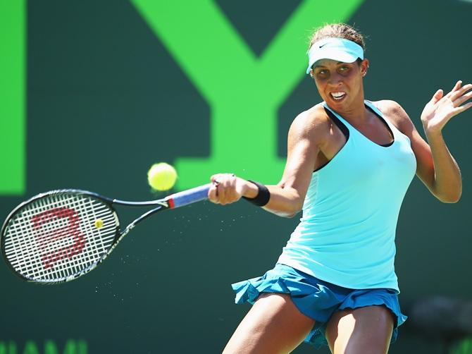 Madison Keys of the USA returns the ball to Li Na of China