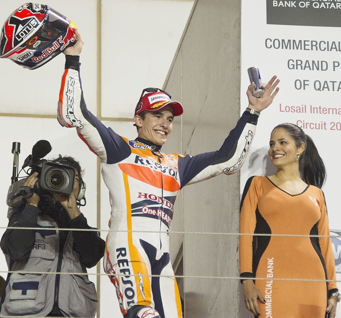 Marc Marquez of Spain and Repsol Honda Team celebrates the victory on the podium at the end of the MotoGP race