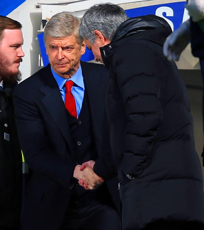 Chelsea manager Jose Mourinho, right, greets Arsenal manager Arsene Wenger