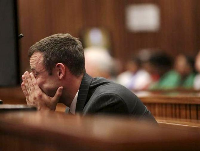 Oscar Pistorius reacts in the dock at the North Gauteng High Court in Pretoria