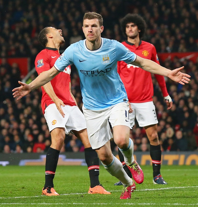 Edin Dzeko of Manchester City celebrates scoring