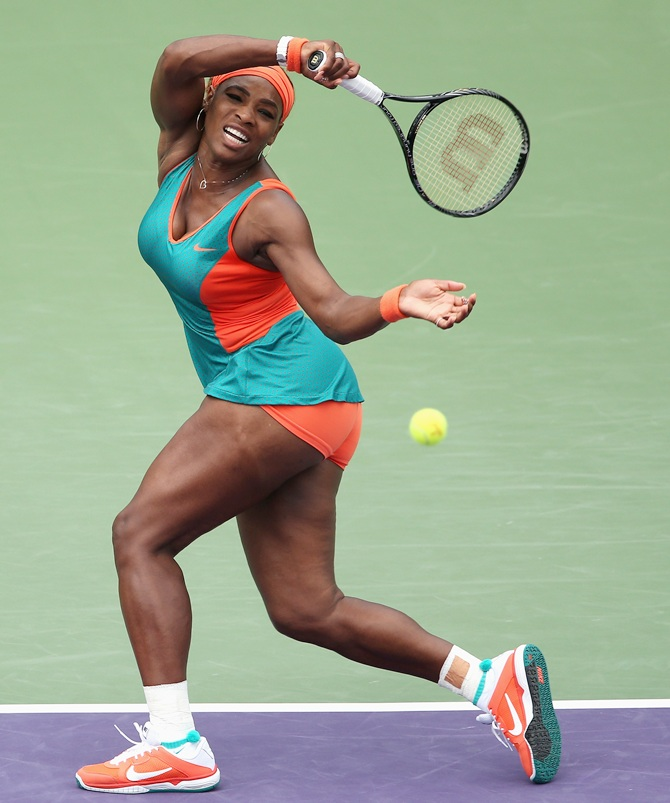 Serena Williams of the United States plays a forehand against Coco Vandeweghe of the United States