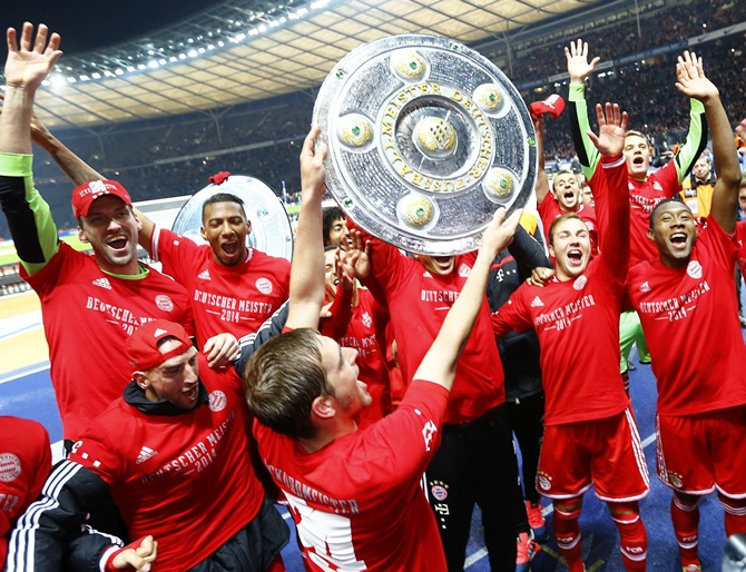 Bayern Munich's players celebrate with mock German soccer championship trophies