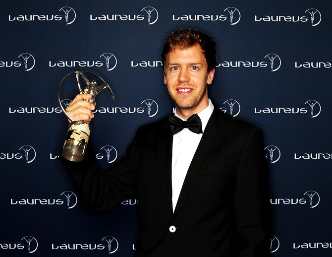Sebastian Vettel poses with the trophy after winning the Laureus World Sportsman of the Year award