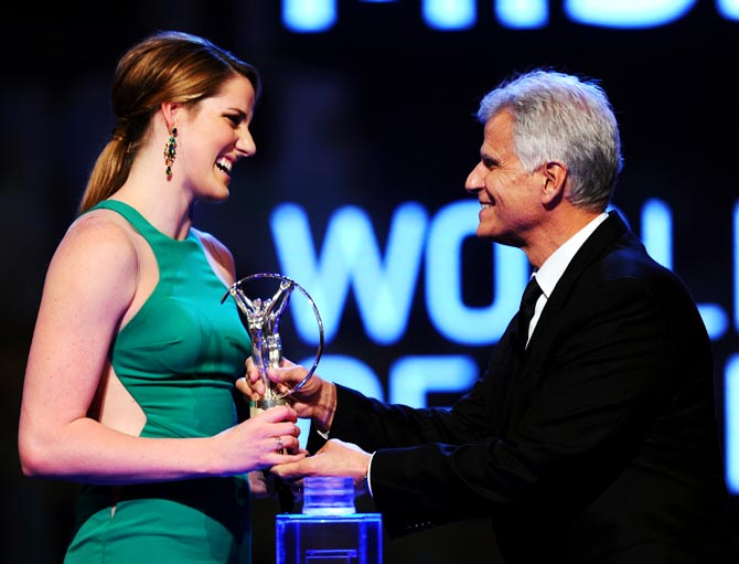 Missy Franklin receives her Laureus World Sportswoman of the Year award from Laureus Academy Member Mark Spitz
