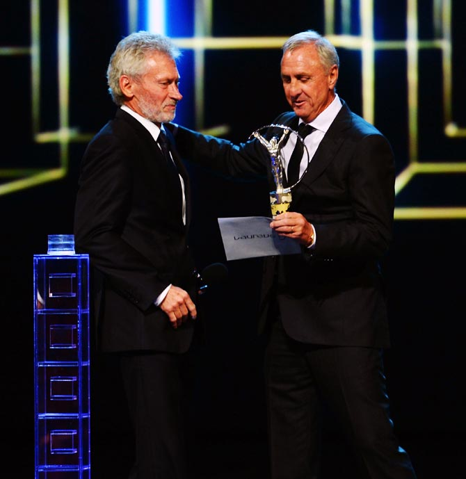 Paul Breitneris collects the Laureus World Team of the Year award on behalf of Bayern Munich from Johan Cruyff