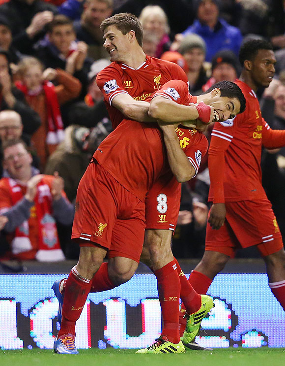 Steven Gerrard of Liverpool celebrates scoring the first goal with teammate Luis Suarez (right) during their English Premier League match against Sunderland at Anfield on Wednesday