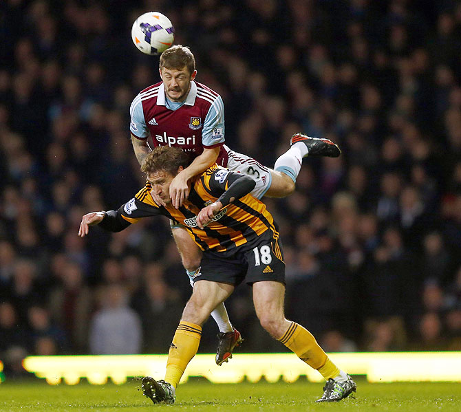 West Ham United's George McCartney (left) challenges Hull City's Nikica Jelavic during their English Premier League match at the Boleyn Ground in London on Wednesday