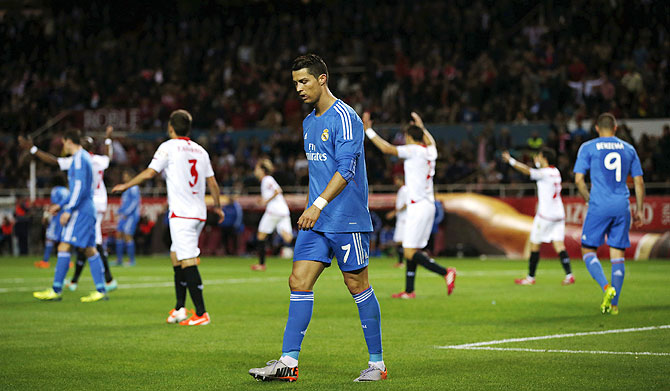 Real Madrid's Cristiano Ronaldo (centre) wears a dejected look during the match against Sevilla at Ramon Sanchez Pizjuan stadium in Seville on Wednesday