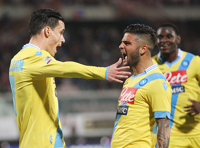 Jose Callejon (left) of Napoli celebrates the seocnd goal wth his teammate Lorenzo Insigne during the Serie A match against Calcio Catania at Stadio Angelo Massimino in Catania, Italy on Wednesday
