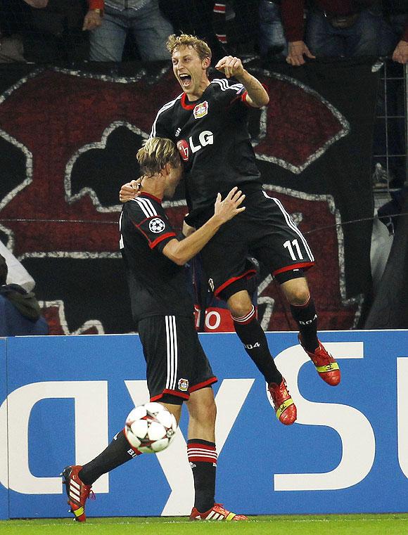 Bayer Leverkusen's Simon Rolfes and Stefan Kiessling (right) celebrate a goal