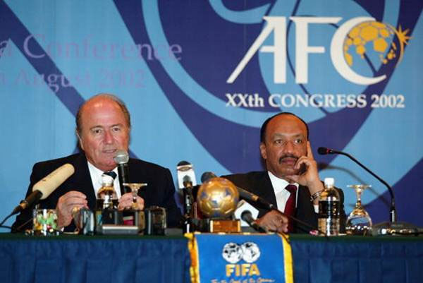 Sepp Blatter, FIFA president and Mohamed bin Hammam, ex-president of the Asian Football Confederation during a press conference at the 2002 AFC Congress
