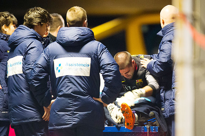 Victor Valdes of FC Barcelona lays injured during the La Liga match against Celta Vigo at Camp Nou in Barcelona on Wednesday