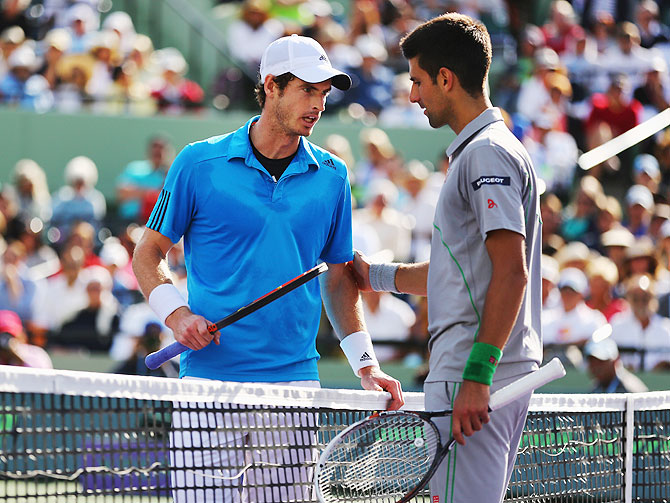 Andy Murray of Great Britain and Novak Djokovic of Serbia discuss the controversial point on Wednesday