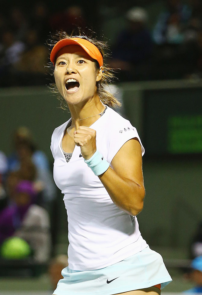 Na Li of China celebrates match point against Caroline Wozniacki of Denmark on Wednesday