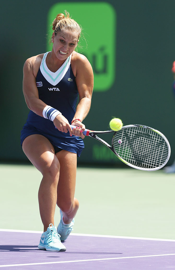 Dominika Cibulkova of Slovakia plays a backhand against Agnieszka Radwanska of Poland