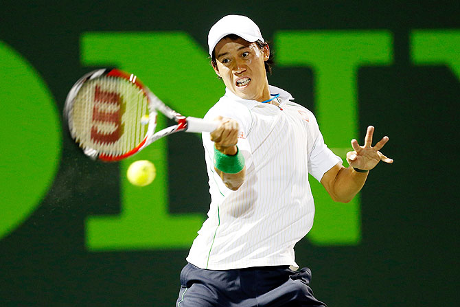 Kei Nishikori hits a forehand against Roger Federer on Wednesday