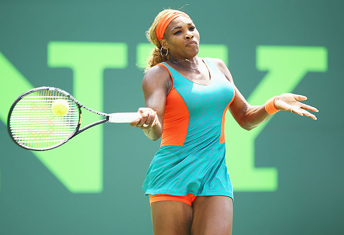 Serena Williams returns a shot against Maria Sharapova on Thursday