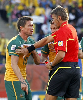 Aussie footballer Harry Kewell argues with a referee