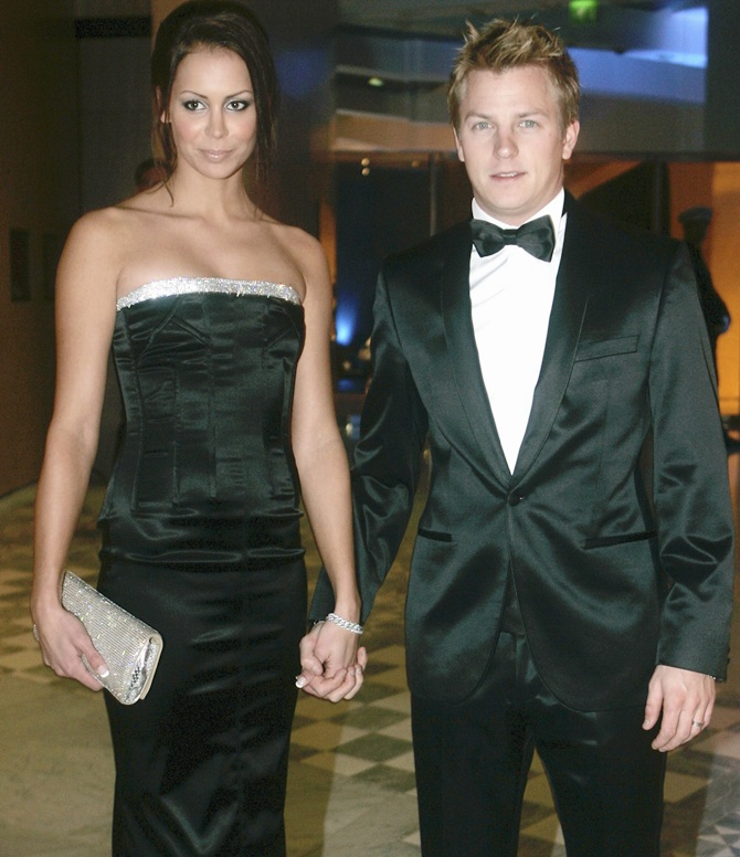 Kimi Raikkonen of Finland and his wife Jenni Dahlman