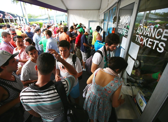 Fans gather at the ticket booth for refunds and exchanges after Tomas Berdych withdrew from his semifinal match