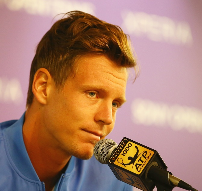 Tomas Berdych speaks to the media after withdrawing