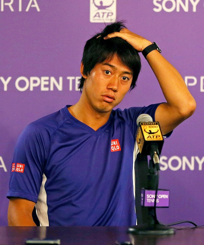 Kei Nishikori speaks at a press conference after withdrawing due to injury prior to his Semifinal match against Novak Djokovic of Serbia