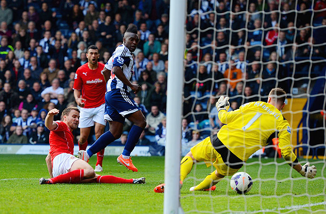 Thievy Bifouma Koulossa of West Brom scores the third goal past David Marshall of Cardiff City on Saturday