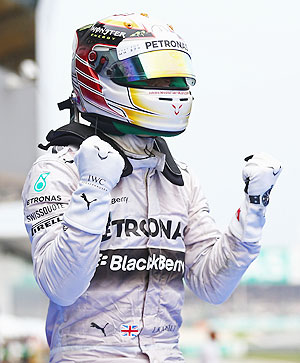 Lewis Hamilton of Great Britain and Mercedes GP celebrates victory after the Malaysia Formula One Grand Prix at the Sepang Circuit in Kuala Lumpur on Sunday