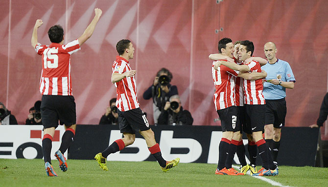 Athletic Bilbao players celebrate a goal by forward Iker Munain against Atletico Madrid on Saturday