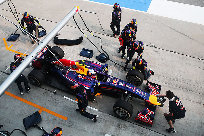Daniel Ricciardo of Australia and Infiniti Red Bull Racing is pushed back into his pitbox during the Malaysia Formula One Grand Prix at the Sepang Circuit on Sunday